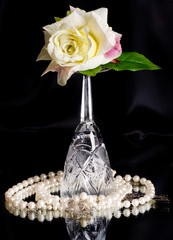 Beautiful wineglass with white rose on black