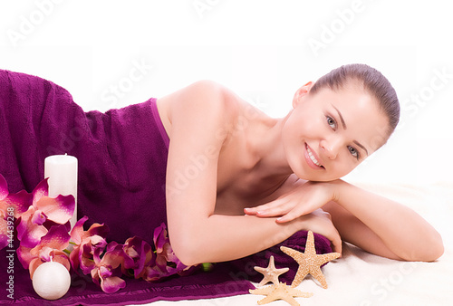 young woman with spa salts and orchid