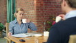 Business colleagues talking and drinking coffee in cafe