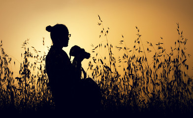 Silhouette of female photographer at sunrise
