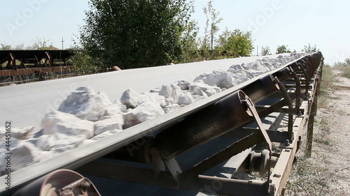Conveyor belt transporting stones