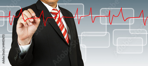 Businessman draw a pulse line