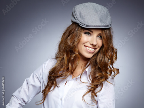 autumn  student smiling against a grey background