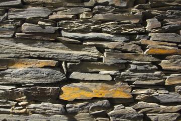 Stone wall. made of slate stone