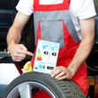 Car mechanic showcases tire label