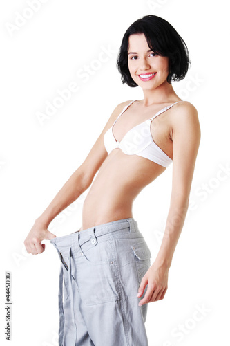 Young fit woman with big pants