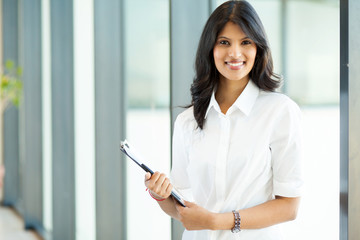 attractive modern young indian businesswoman in office