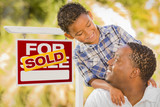 Mixed Race Father and Son In Front of Sold Real Estate Sign