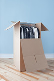 Wardrobe box with clothing, ready for moving poster