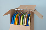 Colorful clothing in a wardrobe box for easy moving poster