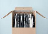 Clothes in a wardrobe box for easy moving poster