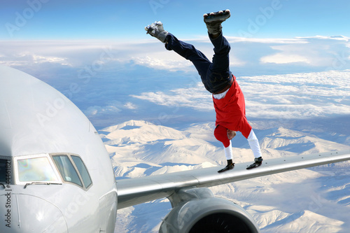 Extreme sport on on the plane wing - 44461821