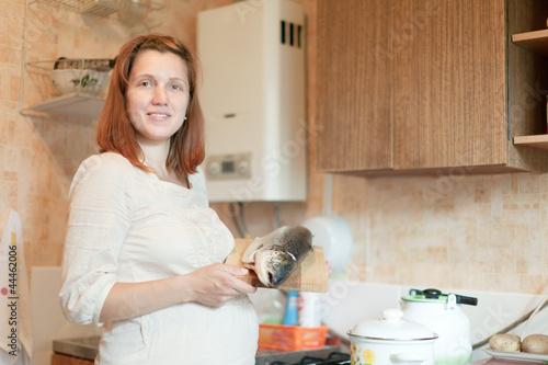 Leinwandbild Motiv pregnant woman with salmon