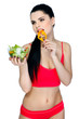 Portrait of a pretty young woman eating vegetable salad
