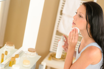 Young woman bathroom clean face make-up removal