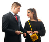 Surprised young businessman giving too much money to the lady