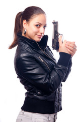 Beautiful girl in black leather jacket and beretta gun