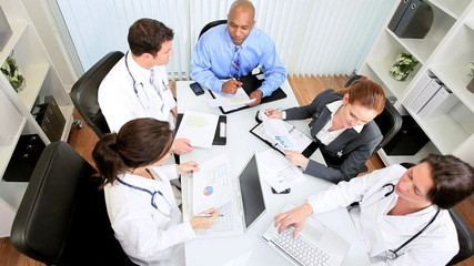 Multi Ethnic Medical Team Meeting with Financial Advisor