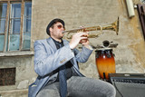 blues musician test the trumpet