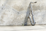 sax in front of a vintage wall