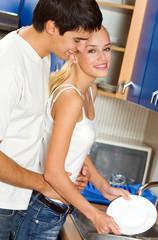 Happy couple washing dishes