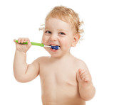Happy child brushing teeth