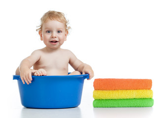 Happy kid wasing in basin