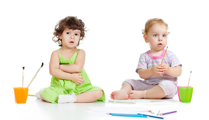 Children group painting with brush in studio isolated