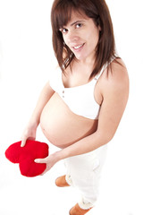 pregnant holds a heart
