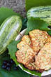 Pancakes with fresh zucchini on grape leaves