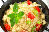 Couscous with salad greens and tomato