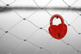 Love padlock on a bridge fence. Russian proverb on it. - 44477071