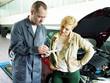 Master mechanic and customer looking at the repair costs