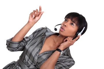 A African American businesswoman with a headset on.