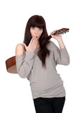 Shy woman stood holding acoustic guitar
