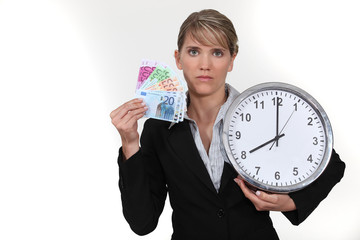 Woman with clock and notes in hand