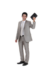 Businessman holding his leather-bound agenda