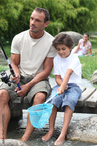 Man out fishing with his son