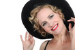 Theatrical woman in a hat