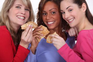 three friends eating pancakes