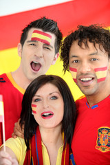 Friends supporting the Spanish soccer team