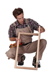 Furniture maker constructing wooden frame