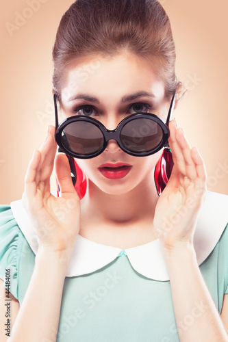 Surprised girl in round sunglasses
