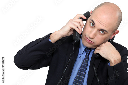 Businessman using two phones