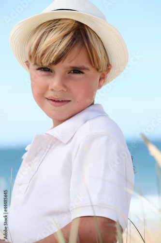 little boy posing on the beach