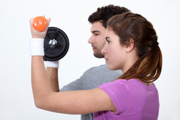 couple lifting weights in profile