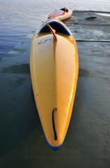 Kayak sul molo al tramonto