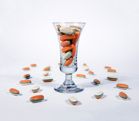 Orange tablests - pills in a glass