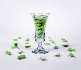 Green tablests - pills in a glass