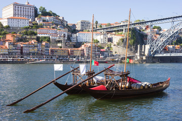 "Porto city, two ""Rebelo"" Boats in the river Douro"